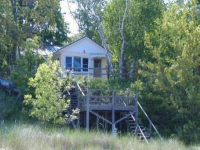 VacationsFRBO Manistee Vacation Rentals Property ID 24635 Manistee Yellow Cottage